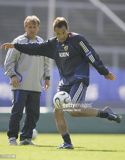 Naohiro Takahara shoots as coach Zico looks on during the training session of Japan National Football Team on June 7 2006 in Bonn Germany Japan will...
