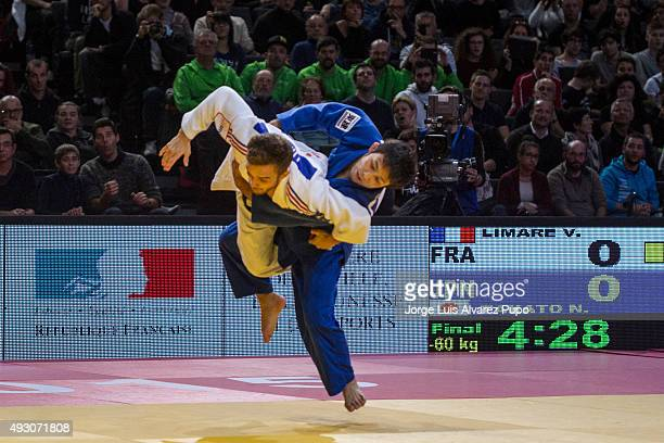 Naohisa Takato from Japan throws Vincent Limare of France during the -60kg Final of the Paris Grand Slam 2015 at the Palais Omnisports de Paris-Bercy...