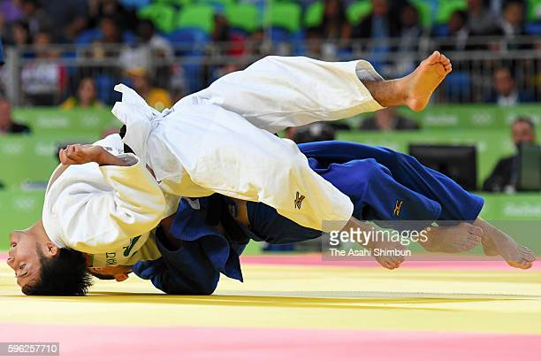 Naohisa Takato of Japan and Amiran Papinashvili of Georgia compete in the Men's -60 kg quarterfinal on Day 1 of the Rio 2016 Olympic Games at Carioca...