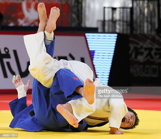 Naohisa Takato of Japan and Beslan Mudranov of Russia compete in the Men's -60kg final during day one of the Judo Grand Slam Tokyo at the Tokyo...