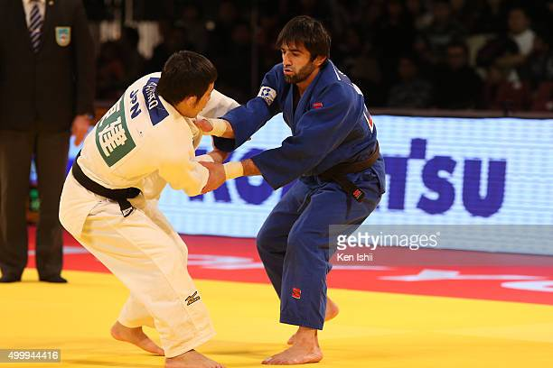 Naohisa Takato of Japan and Beslan Mudranov of Russia compete in the Men's 60kg final match at Tokyo Metropolitan Gymnasium on December 4, 2015 in...