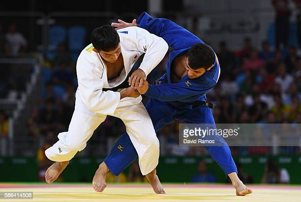 Naohisa Takato of Japan competes against Amiran Papinashvili of Georgia in the Men's -60 kg Judo on Day 1 of the Rio 2016 Olympic Games at Carioca...