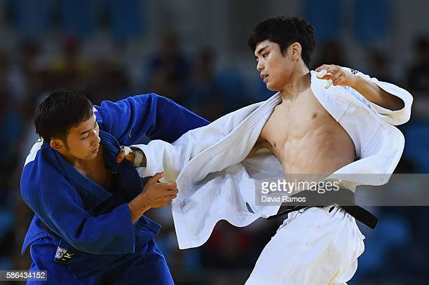 Naohisa Takato of Japan competes against Won Jin Kim of Republic of Korea during the Men's 60 kg Repechage Judo contest on Day 1 of the Rio 2016...