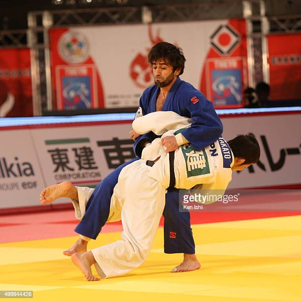 Naohisa Takato of Japan throws Beslan Mudranov of Russia for a ippon in the Men's 60kg final match at Tokyo Metropolitan Gymnasium on December 4,...