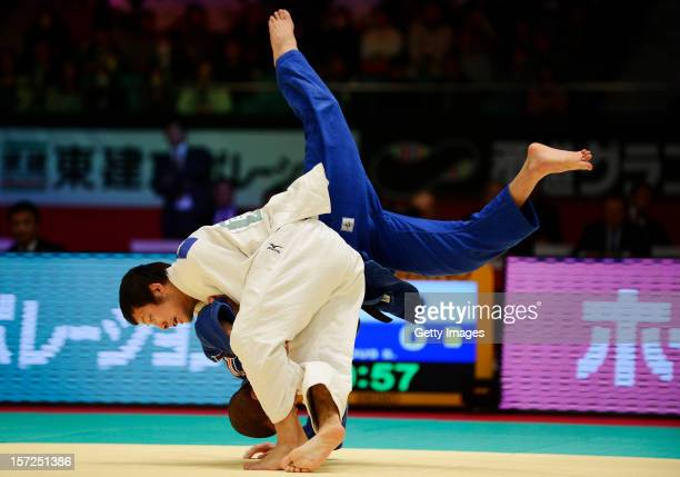 Naohisa Takato of Japan throws Sofiane Milous of France in the Men's 60kg semifinal during day one of the Judo Grand Slamat Yoyogi Gymnasium on...