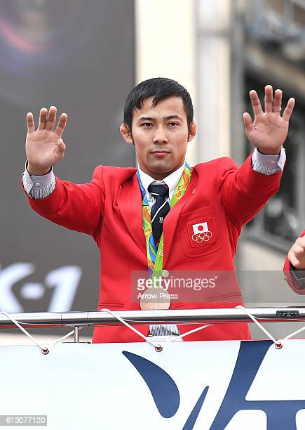 Naohisa Takato waves on the top of a double decker bus during the Rio Olympic Paralympic 2016 Japanese medalist parade in the ginza district on...