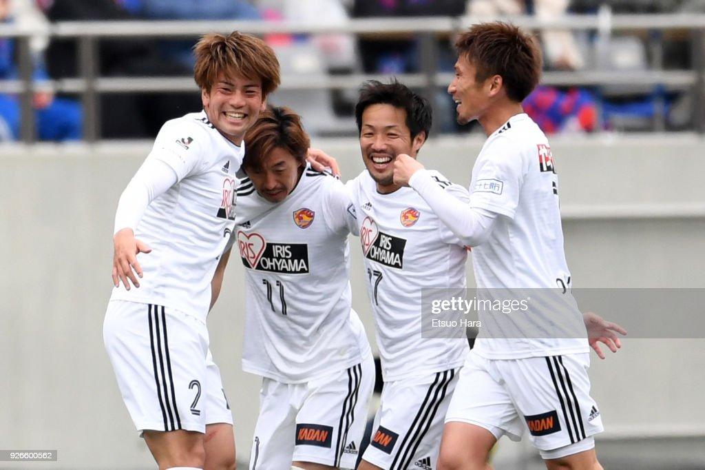 Naoki Ishihara (2ndL) of Vegalta Sendai celebrates scoring his side's first goal during the J.League J1 match between FC Tokyo and Vegalta Sendai at Ajinomoto Stadium on March 3, 2018 in Chofu, Tokyo, Japan.