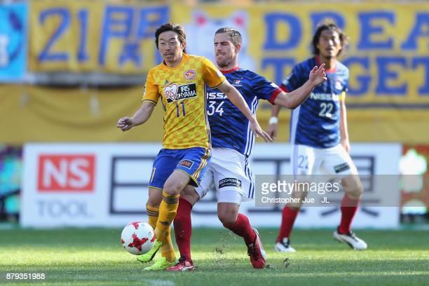 Naoki Ishihara of Vegalta Sendai controls the ball under pressure of Milos Degenek of Yokohama FMarinos during the JLeague J1 match between Vegalta...