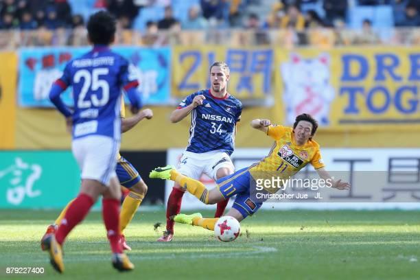 Naoki Ishihara of Vegalta Sendai is challenged by Milos Degenek of Yokohama FMarinos during the JLeague J1 match between Vegalta Sendai and Yokohama...