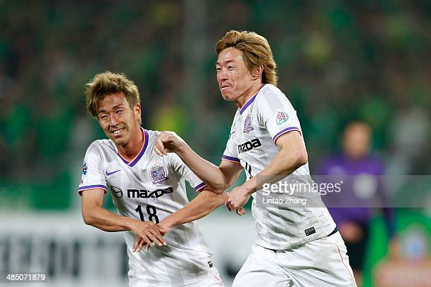 Naoki Ishihara with teammate Yoshifumi Kashiwa of Sanfrecce Hiroshima celebrates scoring their second goal during the AFC Champions match between...