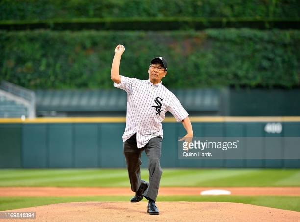 Naoki Itothe consulategeneral of Japan in Chicago throws a ceremonial first pitch before the game between the Chicago White Sox and the Texas Rangers...