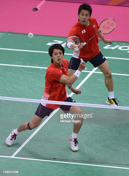 Naoki Kawamae and Shoji Sato of Japan compete during their Men's Doubles Badminton match between Tony Gunawan and Howard Bach of the United States on...
