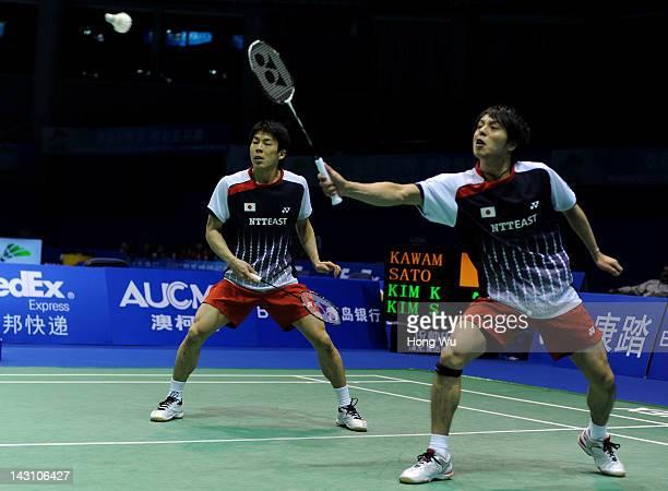 Naoki Kawamae and Shoji Sato of Japan play a shot during their match against Kim Ki Jung and Kim Sa Rang of Korea during day Three of the 2012...