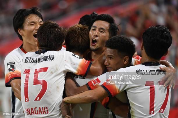 Naoki Maeda of Nagoya Grampus celebrates the opener with Mateus and others of Nagoya Grampus during the J.League Meiji Yasuda J1 match between Nagoya...