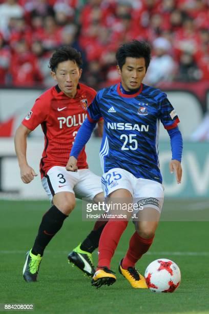 Naoki Maeda of Yokohama FMarinos controls the ball under pressure of Tomoya Ugajin of Urawa Red Diamonds during the JLeague J1 match between Urawa...