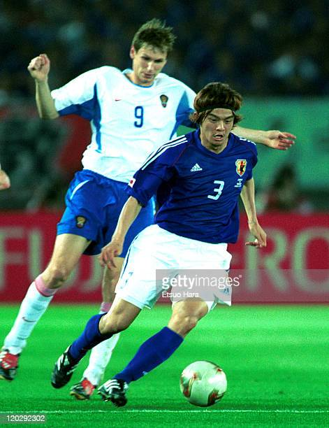 Naoki Matsuda of Japan and Egor Titov of Russia during the 2002 FIFA World Cup Korea Japan Group H match between Japan and Russia at International...