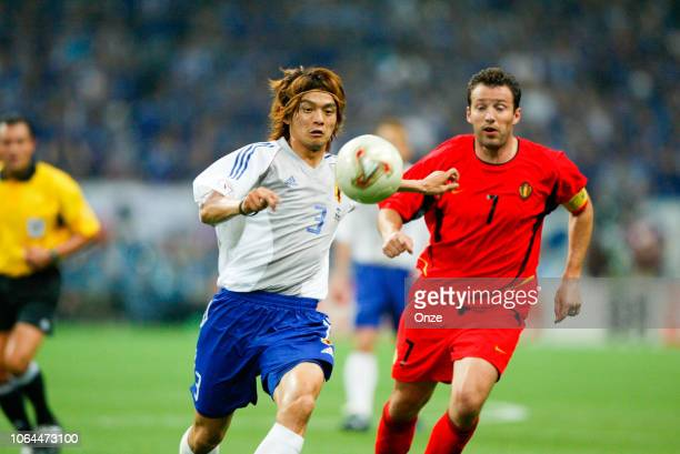 Naoki Matsuda of Japan and Marc Wilmots of Belgium during the World Cup match between Japan and Belgium in Saitama Stadium in Saitama Japan on June...