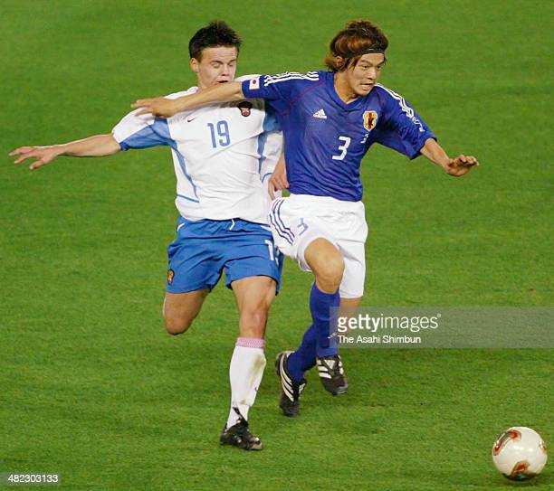 Naoki Matsuda of Japan and Ruslan Pimenov of Russia compete for the ball during the FIFA World Cup Korea/Japan Group H match between Japan and Russia...