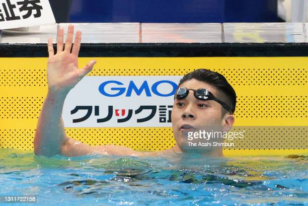 Naoki Mizunuma celebrates winning the Men's 100m Butterfly final on day seven of the 97th Japan Swimming Championships at the Tokyo Aquatics Centre...