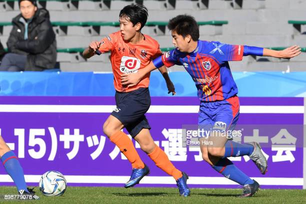 Naoki Suto of Omiya Ardija and Soma Anzai of FC Tokyo compete for the ball during the Prince Takamado Cup 29th All Japan Youth Football Tournament...