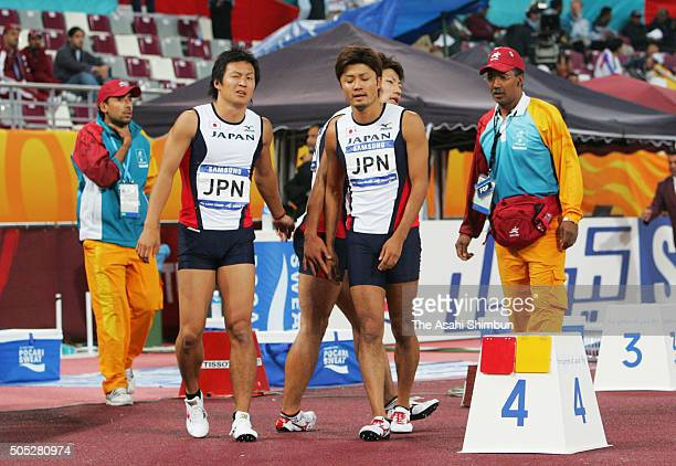 Naoki Tsukahara and Shingo Suetsugu of Japan react after finishing second in the Men's 4x100m Relay during day eleven of the 15th Asian Games at the...