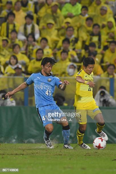 Naoki Wako of Kashiwa Reysol and Akihiro Ienaga of Kawasaki Frontale compete for the ball during the JLeague J1 match between Kashiwa Reysol and...