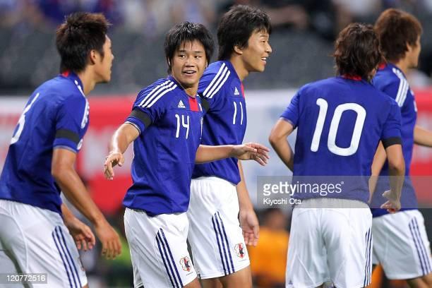 Naoki Yamada of Japan U22 celebrates with teammates after scoring during the international friendly match between Japan U22 and Egypt U22 at Sapporo...