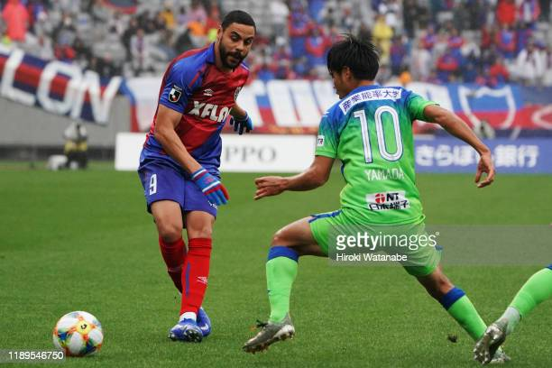 Naoki Yamada of Shonan Bellmare and Diego Oliveira of FC Tokyo compete for the ball during the J.League J1 match between FC Tokyo and Shonan Bellmare...