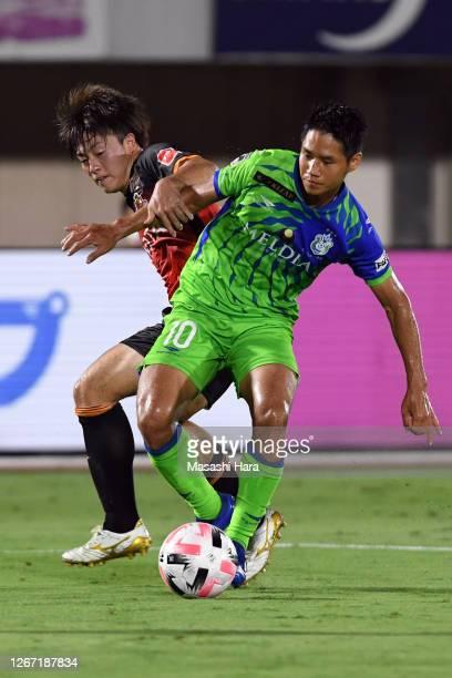 Naoki Yamada of Shonan Bellmare and Naoki Soma of Nagoya Grampus compete for the ball during the J.League Meiji Yasuda J1 match between Shonan...