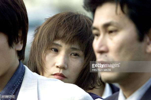 Naoko Nakata and other relatives of the victims of the Japanese fishing vessel Ehime Maru talk with reporters as they leave the courtroom at the the...
