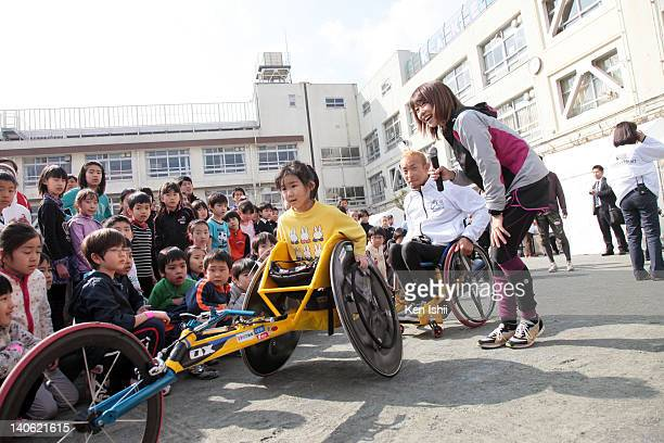 Naoko Takahashi and Jun Hiromichi attends the Sports of Heart at primary school on March 3 2012 in Tokyo Japan