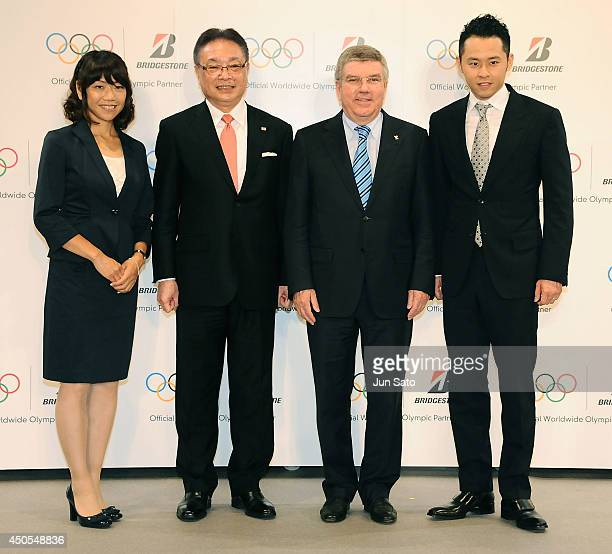 Naoko Takahashi Bridgestone CEO Masaaki Tsuya President of International Olympic Committee Thomas Bach and Kosuke Kitajima pose for a photo during a...