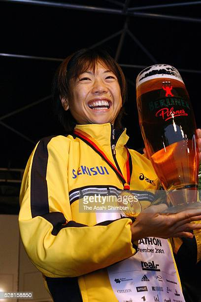 Naoko Takahashi of Japan celebrates at the medal ceremony after winning the Berlin Marathon on September 30 2001 in Berlin Germany