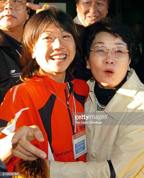Naoko Takahashi of Japan celebrates winning with her mother Shigeko after the 27th Tokyo International Women's Marathon at the National Stadium on...