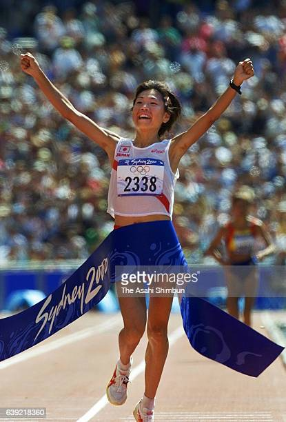 Naoko Takahashi of Japan crosses the finish tape to win the gold in the Women's Marathon during the Sydney Olympics at Stadium Australia on September...