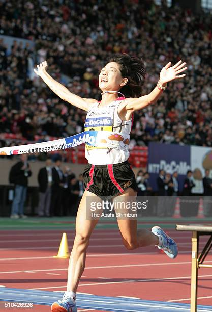 Naoko Takahashi of Japan crosses the finishing tape to win during the 27th Tokyo International Women's Marathon at the National Stadium on November...