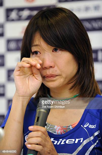 Naoko Takahashi sheds tears during a press conference as she retires after the Nagoya International Women's Marathon at Mizuho Athletic Stadium on...