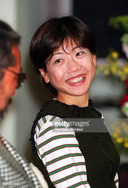 Naoko Takahashi smiles during a press conference after the Japanese marathon runners for the Sydney Olympic Games announced on March 13 2000 in Tokyo...