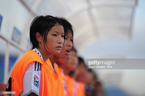 Naoko Wada of Japan watches from the bench during the FIFA U17 Women's World Cup Group C match between Spain and Japan at the Ato Boldon Stadium on...