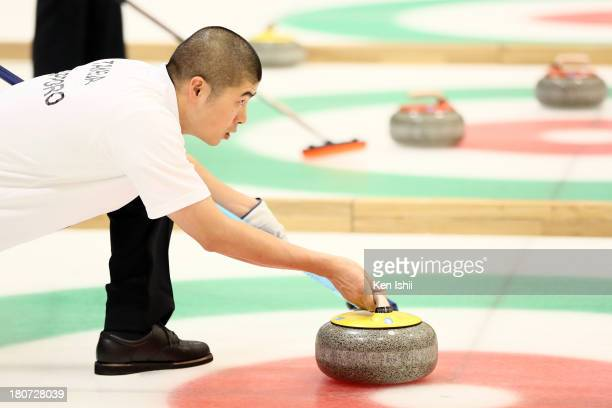 Naomasa Takeda of Sapporo throws a stone during Game Three of the Curling Japan Qualifying Tournament between SC Karuizawa and Sapporo at Dohgin...