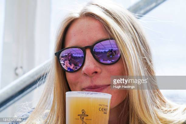 Naomi Bailey-Carpenter from St Ives, Cornwall, enjoys a drink at the Working Boat pub at the Greenbank Hotel, on April 12, 2021 in Falmouth, England....