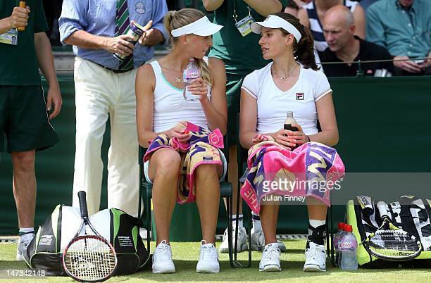 Naomi Broady and Johanna Konta of Great Britain take a break during their Ladies' Doubles first round match against Kveta Peschke of the Czech...