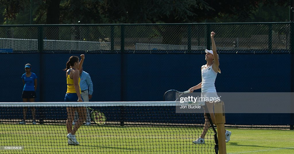 Naomi Broady of Great Britain and Anastasia Sevastova of Latvia celebrate during their match against Yifan Xu and Saisai Zheng of China on day four of the WTA Aegon Open on June 9, 2016 in Nottingham, England.