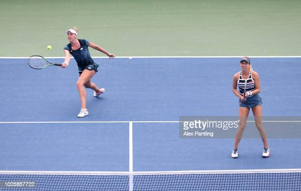 Naomi Broady of Great Britain and Danielle Collins of The United States during their ladies doubles Second round match against Timea Bacsinszky of...