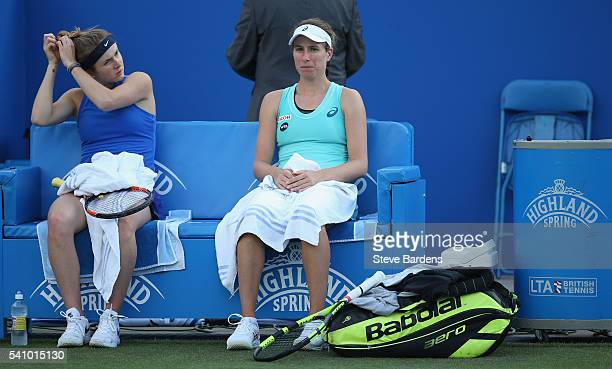 Naomi Broady of Great Britain and Heather Watson of Great Britain talk during their women's doubles quarter final against Johanna Konta of Great...