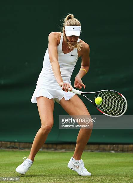 Naomi Broady of Great Britain in action during her Ladies' Singles first round match against Timea Babos of Hungary on day one of the Wimbledon Lawn...