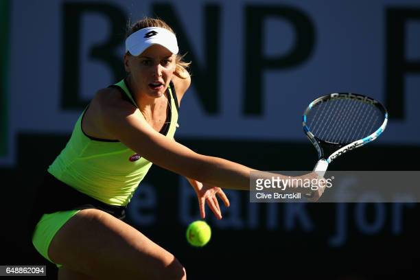 Naomi Broady of Great Britain plays a backhand against Tereza Martincova of the Czech Republic in her first round qualifying match during day one of...