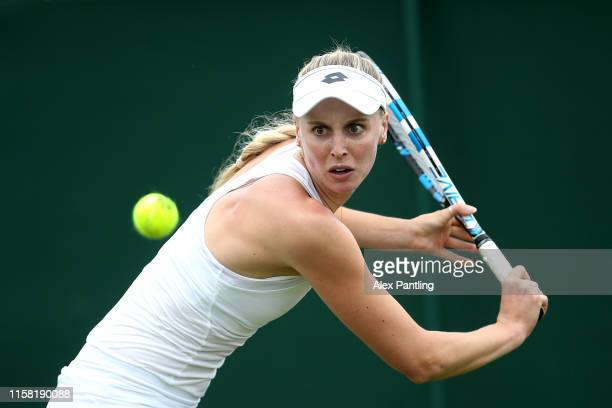 Naomi Broady of Great Britain plays a backhand during her singles match against Kristie Ahn of The United States during qualifying prior to The...
