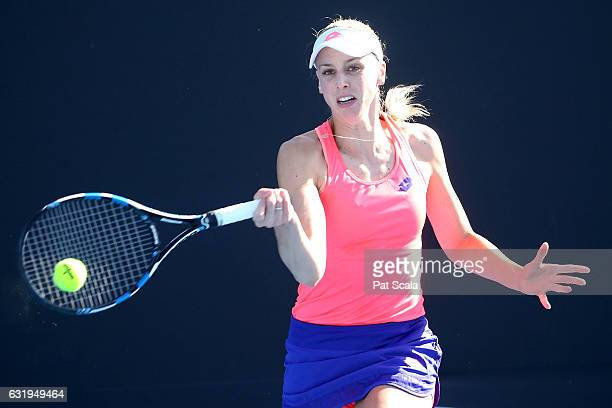 Naomi Broady of Great Britain plays a forehand in her first round doubles match with Heather Watson against Karin Knapp and Mandy Minella on day...
