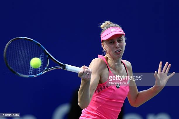 Naomi Broady of Great Britain plays a forehand shot to Eugenie Bouchard of Canada during the Semi Finals of the 2016 BMW Malaysian Open at Kuala...